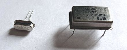 Quartz crystal resonator (left) and quartz crystal oscillator (right) 18MHZ 12MHZ Crystal 110.jpg