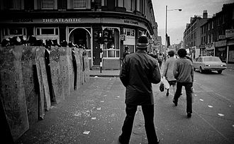 Death of Keith Blakelock - Police line up with shields (left) by Coldharbour Lane during the 1981 Brixton riots.