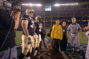 The coin flip at the inaugural Poinsettia Bowl.