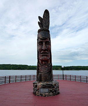 Peter Wolf Toth - Toth's Nee-Gaw-Nee-Gaw-Bow (Leading Man, 1988) in Wakefield, Michigan was carved from one piece of pine donated by the Ottawa National Forest.