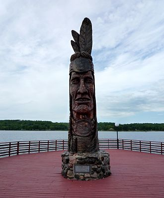 Wakefield, Michigan - Nee-Gaw-Nee-Gaw-Bow (Leading Man), by Peter Wolf Toth (1988), to honor the Chippewa Indians; it is located on the lakeside pier next to the Wakefield Visitor's Center and was carved from one piece of pine donated by the Ottawa National Forest. It is one of Toth's Whispering Giants.