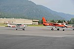2016. Aerial survey aircraft. Cessna 182 (N103AS) and USDI Quest Kodiak (N710). Western States fly-in. Sandpoint, Idaho. (41809366222).jpg