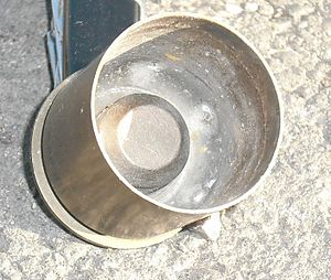 40 mm grenade - Inside view of a spent casing for a 40 mm grenade, showing the internal pressure chamber for the high-low pressure system.