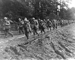 442nd Infantry Regiment (United States) - The 442nd Regimental Combat Team hiking up a muddy road in the Chambois Sector, France, in late 1944.