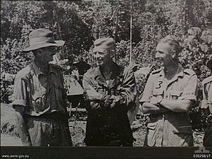 41st Infantry Division (United States) - Allied commanders at Sanananda. Major General George Alan Vasey, Commanding 7th Division (left), chatting to Colonel J. A. Doe, 163rd Infantry (centre).