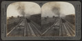 A Busy Path of Commerce in Central New York - Four Track Railway. Electric Road at right, Erie Canal at extreme left, by Keystone View Company.png