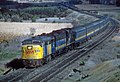 A Four Shot Sequence of a Canadian ALCo and Train (35086217036).jpg