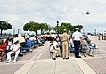 A U.S. Navy MH-60S Sea Hawk helicopter flies by during a 9-11 remembrance ceremony at the Key West-Florida Keys Historic Military Memorial in Key West, Fla., Sept 140911-N-YB753-006.jpg