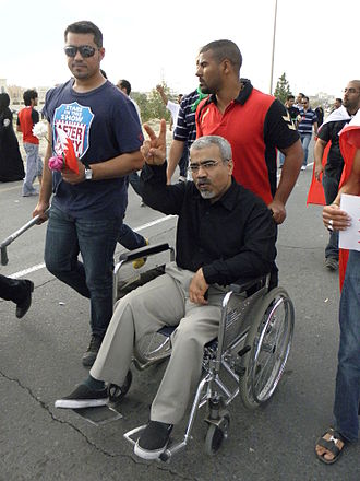 Bahrain Thirteen - Abduljalil al-Singace on his wheel chair, taking part in a protest heading to the Royal Court in Riffa