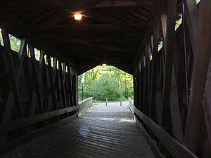 Ada Covered Bridge - Inside, showing Brown truss stringers.
