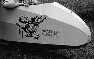 Akaflieg München Mü10 Milan - A close-up of the nose showing the Akaflieg München logo.