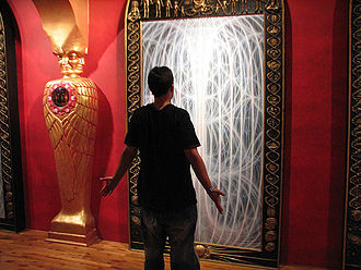 Alex Grey - A visitor appreciates a piece of art.