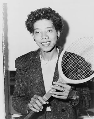 Althea Gibson, half-length portrait, holding t...