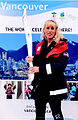 American Athlete Tracy Mattes with the Olympic Torch at the 2010 Vancouver Winter Olympic Games.jpg
