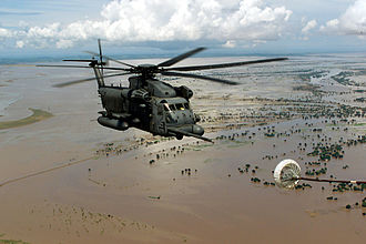 21st Special Operations Squadron - MH-53M Pave Low IV helicopter approaches the refueling basket of an MC-130P Combat Shadow for in-flight refueling as they fly over flooded Central Mozambique, 20 March 2000