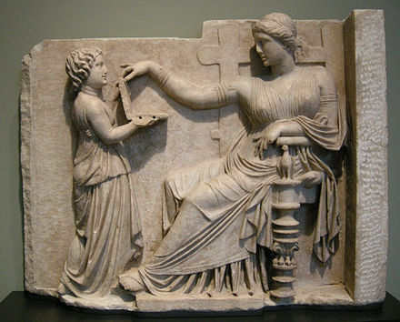 Geoffrey Hosking suggests that fear of being enslaved was a central motivating force for the development of the Greek sense of citizenship. Sculpture: a Greek woman being served by a slave-child. Arte greca, pietra tombale di donna con la sua assistente, 100 ac. circa.JPG