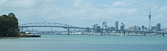 Birkenhead, New Zealand - A view from Chelsea showing the Auckland Harbour Bridge and CBD. Birkenhead Wharf can be seen on the left, at the head of Birkenhead Point.