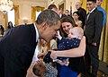 Barack Obama plays with 5 month-old Vann Carroll, 2014.jpg