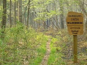 Photo of a sign at the entrance to Barbours Creek Wilderness along a hiking trail