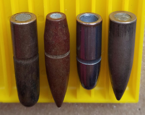 Full metal jacket bullet - These .30-caliber (7.62 mm) full metal jacket bullets show the typical jacket openings exposing the lead alloy core on the base of the bullet to illustrate a full metal jacket may not completely enclose the core.