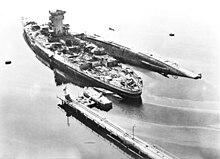 220px-Battleship_Strasbourg_after_bomb_a