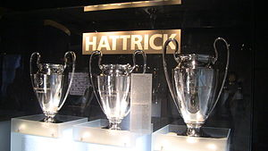 European Champion Clubs' Cup - The three consecutive European Cup trophies won by Bayern Munich, 1974–76. The one on the far right is the real Champions League trophy, given to Bayern permanently in 1976. The ones on the left are slightly smaller replicas.