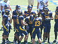 Bears in huddle at UC Davis at Cal 2010-09-04 2.JPG