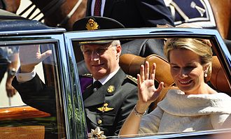 Philippe of Belgium - King Philippe and Queen Mathilde wave to the crowds in Brussels after Philippe's swearing in as new Belgian monarch.