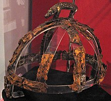 Colour photograph of the Benty Grange helmet, which has a freestanding boar atop its crest