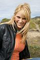 Blonde woman in black leather and orange shirt.jpg
