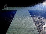Blue wooden dock submerged.jpg