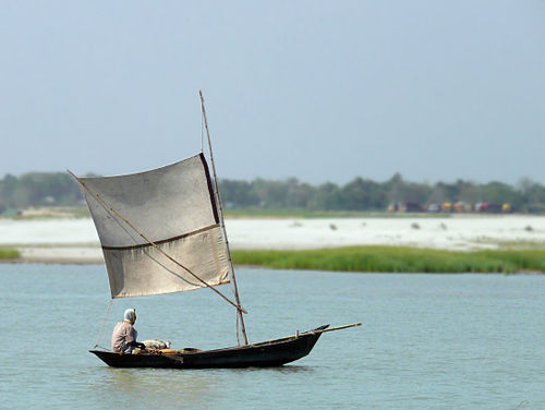 Boat Sailing up Padma River Bangladesh.jpg