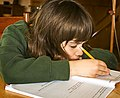 Boy doing homework (4596604619).jpg