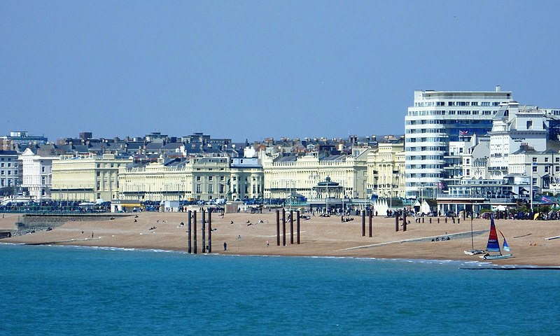 The buildings of the western part of Brighton seafront (and just into Hove), seen from the Palace Pier. Visible from left to right are, among others, Adelaide Crescent, Brunswick Terrace, Embassy Court and the Norfolk Hotel.