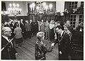 Burgemeester IJsselmuiden schudt handen tijdens de Nieuwjaarsreceptie in het raadhuis te Halfweg. NL-HlmNHA 54023546.JPG