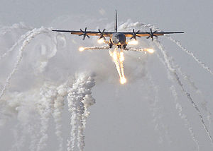 A British C-130J Hercules aircraft launches fl...