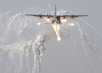 War on Terror - A British C-130J Hercules aircraft launches flare countermeasures before being the first coalition aircraft to land on the newly reopened military runway at Baghdad International Airport