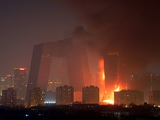 Beijing Television Cultural Center fire - The 44-story TVCC building in flames (right); the CCTV Headquarters (left)