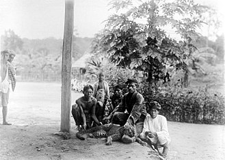 Javan leopard - Men and a child with a newly shot leopard in Banten, West Java, circa 1915-1926.