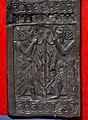 Carved ivory panel showing young bearded Egyptian men flanking lotus stem and flowers. From Nimrud, Iraq. Iraq Museum.jpg