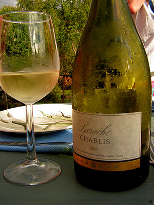 A glass of the French wine Chablis made from C...