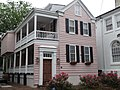 Charleston house painted pink house with red roses (8975090275).jpg