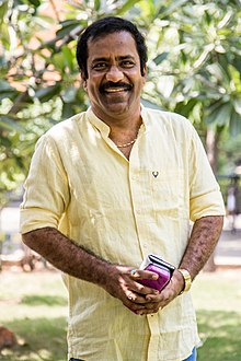 Charlie at Maanagaram Press Meet.jpg