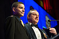 Chief of Staff of the U.S. Air Force Gen. Mark A. Welsh, right, speaks on stage after receiving the Honor Guard Award with the surviving son of Army Sgt. 1st Class Carlos Santos-Silva March 27, 2014, during 140327-D-KC128-149.jpg