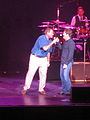 Chris Berman sings with Huey Lewis.jpg