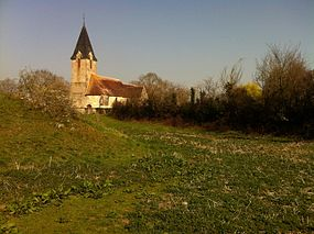 Church in Bailleul with motte in foreground.JPG