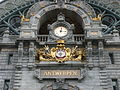 Clock and city coat of arms Antwerpen Centraal Station.jpg