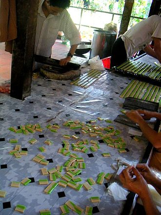 Candy making - Coconut candy being prepared in the Mekong delta area, Vietnam