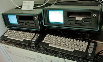 Commodore SX-64 - Two Commodore SX-64 computers showing their SX-64 BASIC 2.0 startup screens. (Note the white screen background color.)