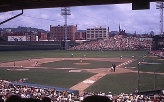 Crosley Field - Crosley Field on August 16, 1969 during its final full season. Note the Coca-Cola ad behind the bleachers, and a Pepsi logo outside the park